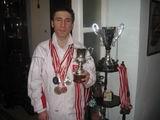 Kerim Altınok Millî Eşofmanlı,madalya ve kupalarıyla